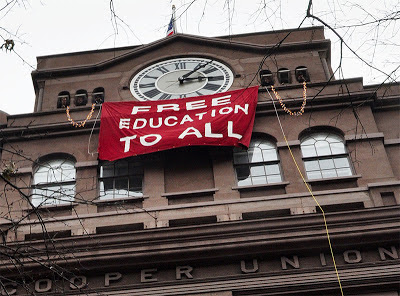 "Banner, ""Free Education to All,"" hanging out window of Cooper Union for the Advancement of Science and Art in New York"