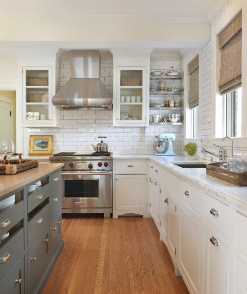 white kitchen with gray island content in a cottage On gray and white kitchen