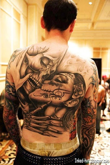 Body Art | Skull kissing tattoo on back