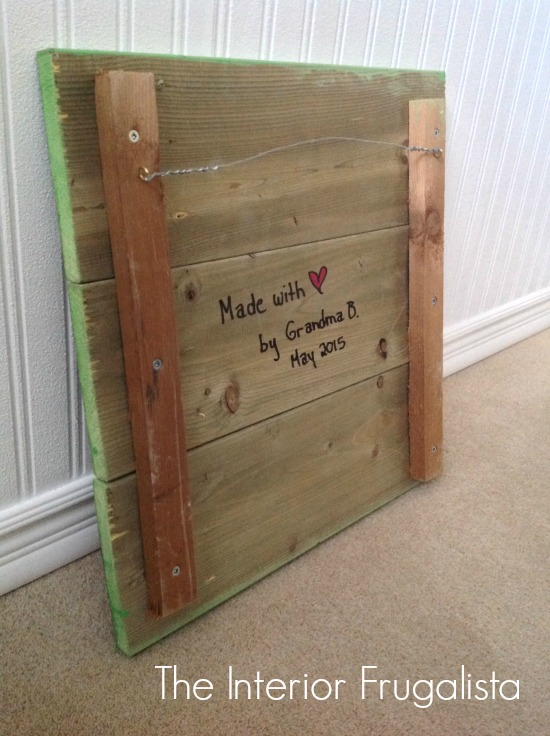 Writing a special message onto the back of Nursery Pallet Art
