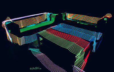 Art by Ben Heine - Sofa and table surrounded by Led Lights - Long Exposure Photo