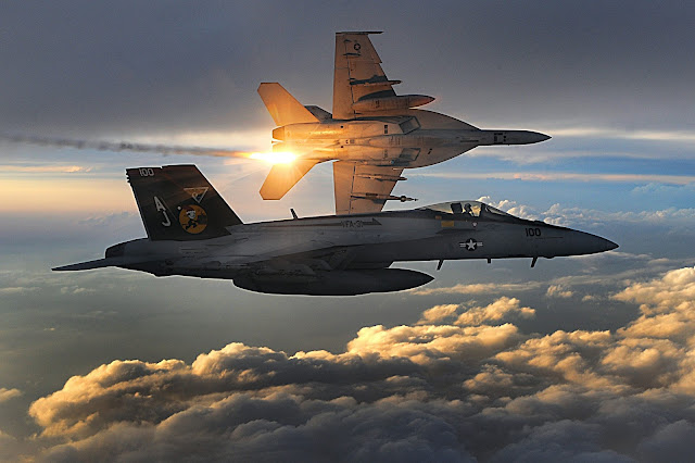 U.S. Navy F/A-18 Super Hornets deploy heat flares
