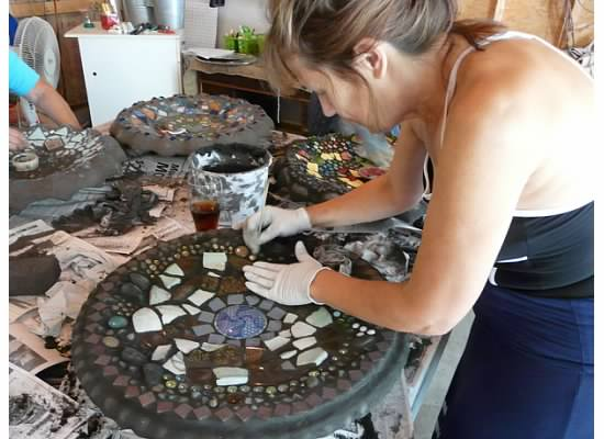Student grouting in private workshop