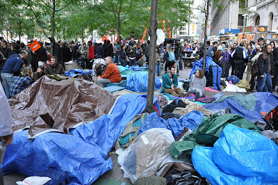 Photograph of protesters' belongings covered with tarps