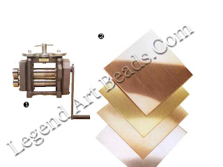1 Rolling mill for compressing sheets of soldered metals; 2 sheets of silver, copper and brass to be soldered together.