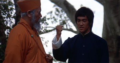 Bruce Lee in Enter the Dragon opening