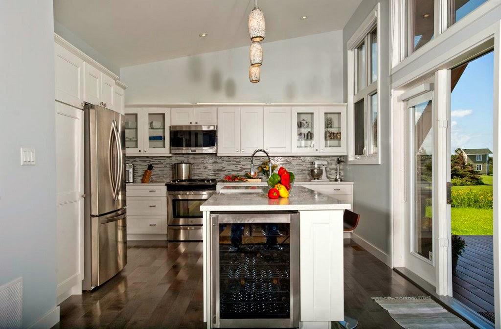 modelo de casa de una planta con techo alto foto cocina