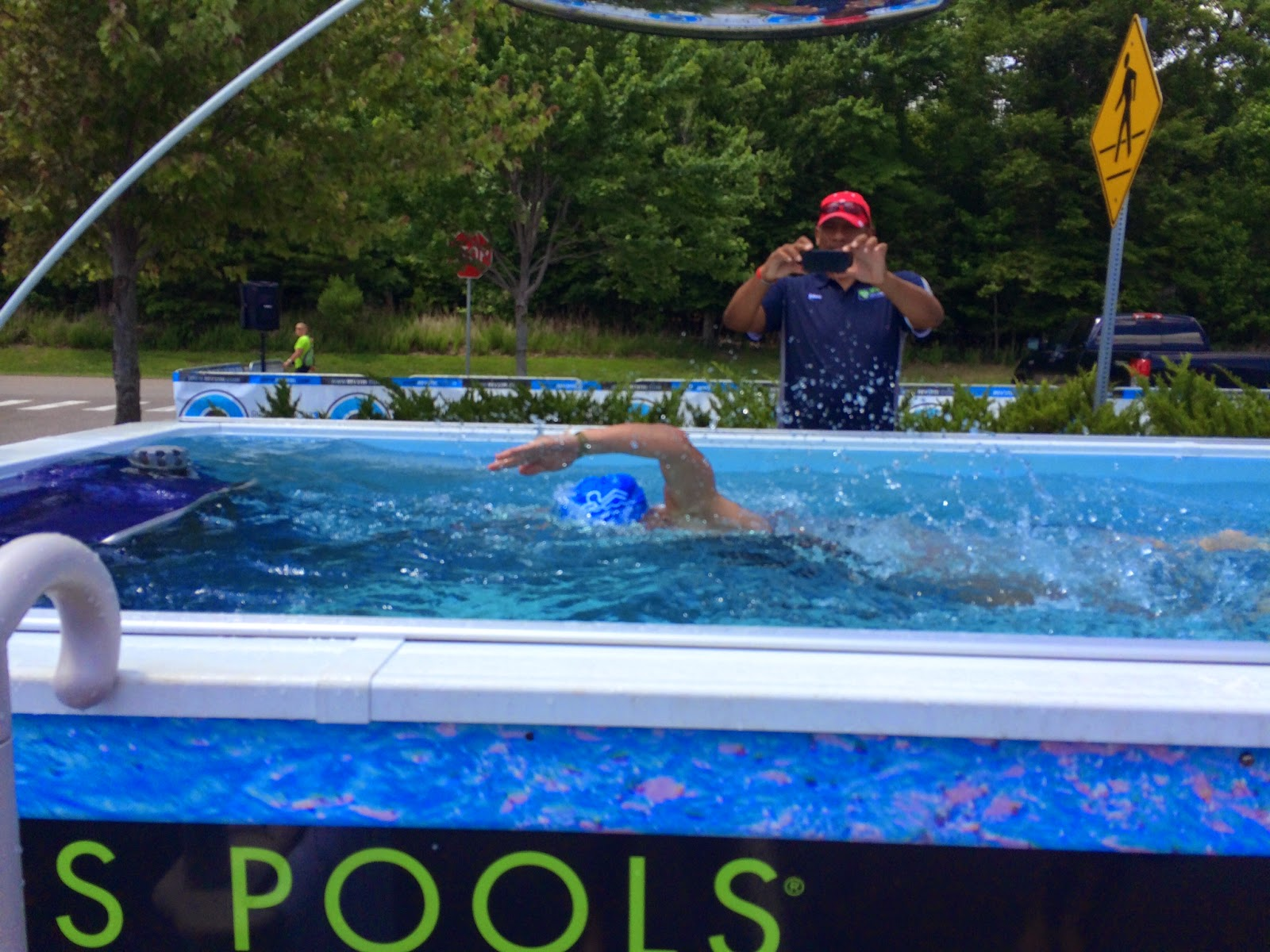 An Endless Pool swimmer gets photographed from both sides at the REV3 Triathlon in Williamsburg, VA.