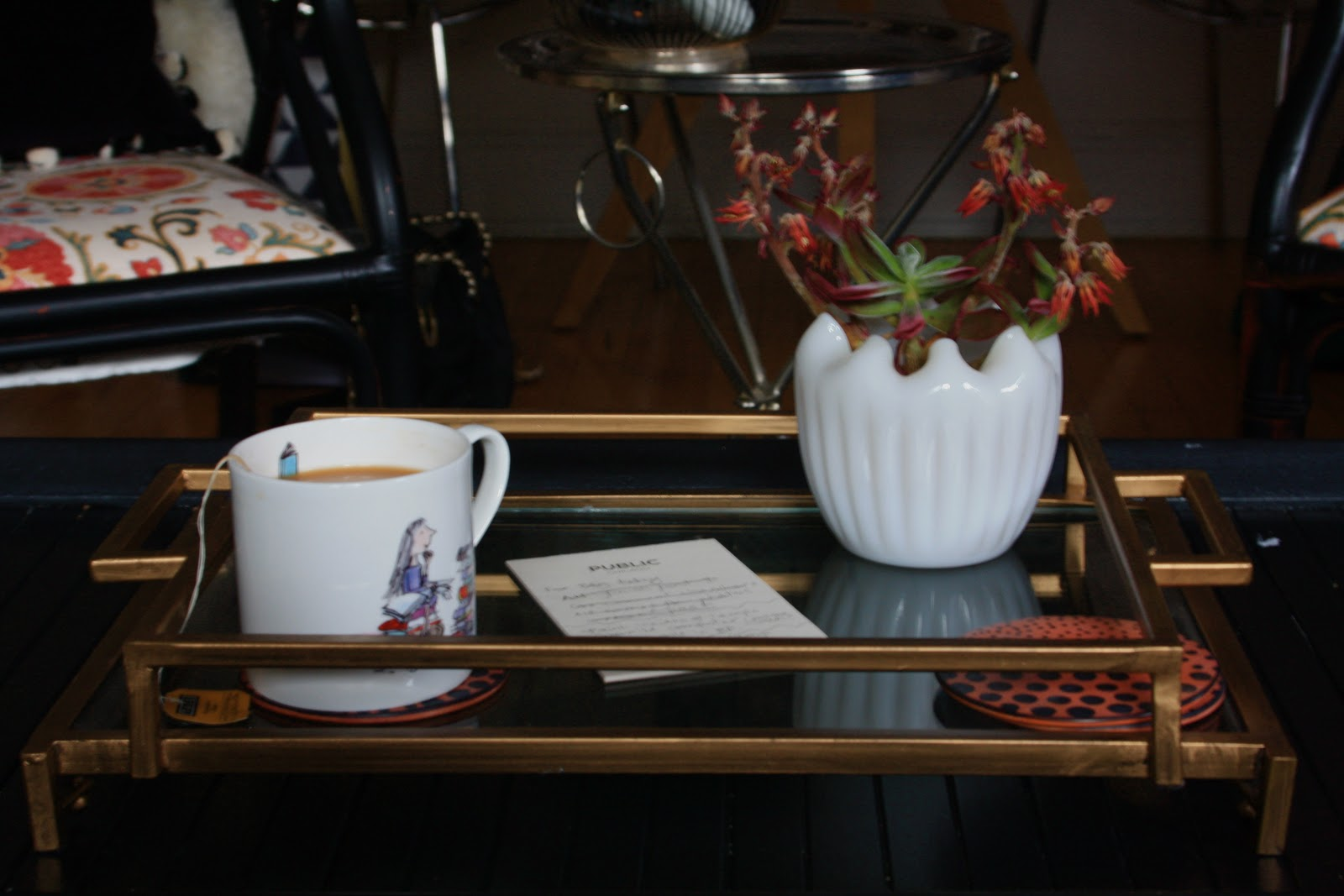 living room, gold Threshold Target tray, and Matilda mug