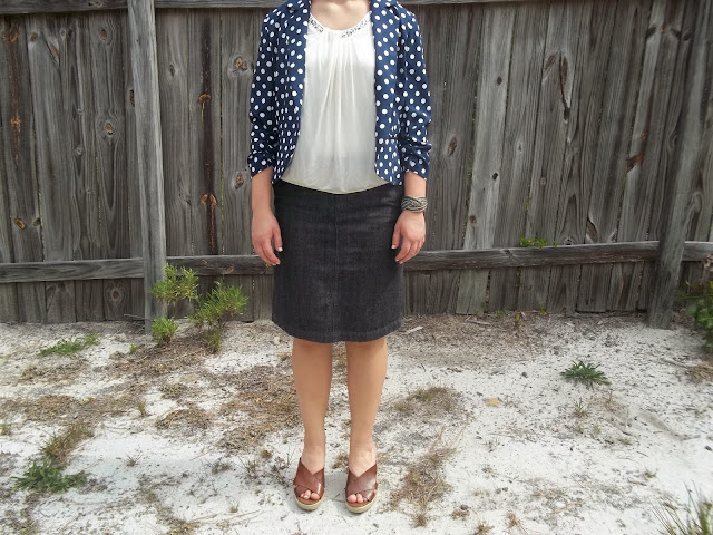 Capsule Wardrobe Outfit #3:Patterned Blazer. Polka dot blazer, white blouse, jean pencil skirt, brown wedges, statement bracelet. #capsulewardrobe #outfit #BowsandClothes #ootd