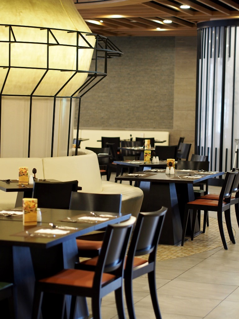 strategically located at the gardens mall it was recently been refurbished and has turned in to a vibrant and stylish all day dining restaurant
