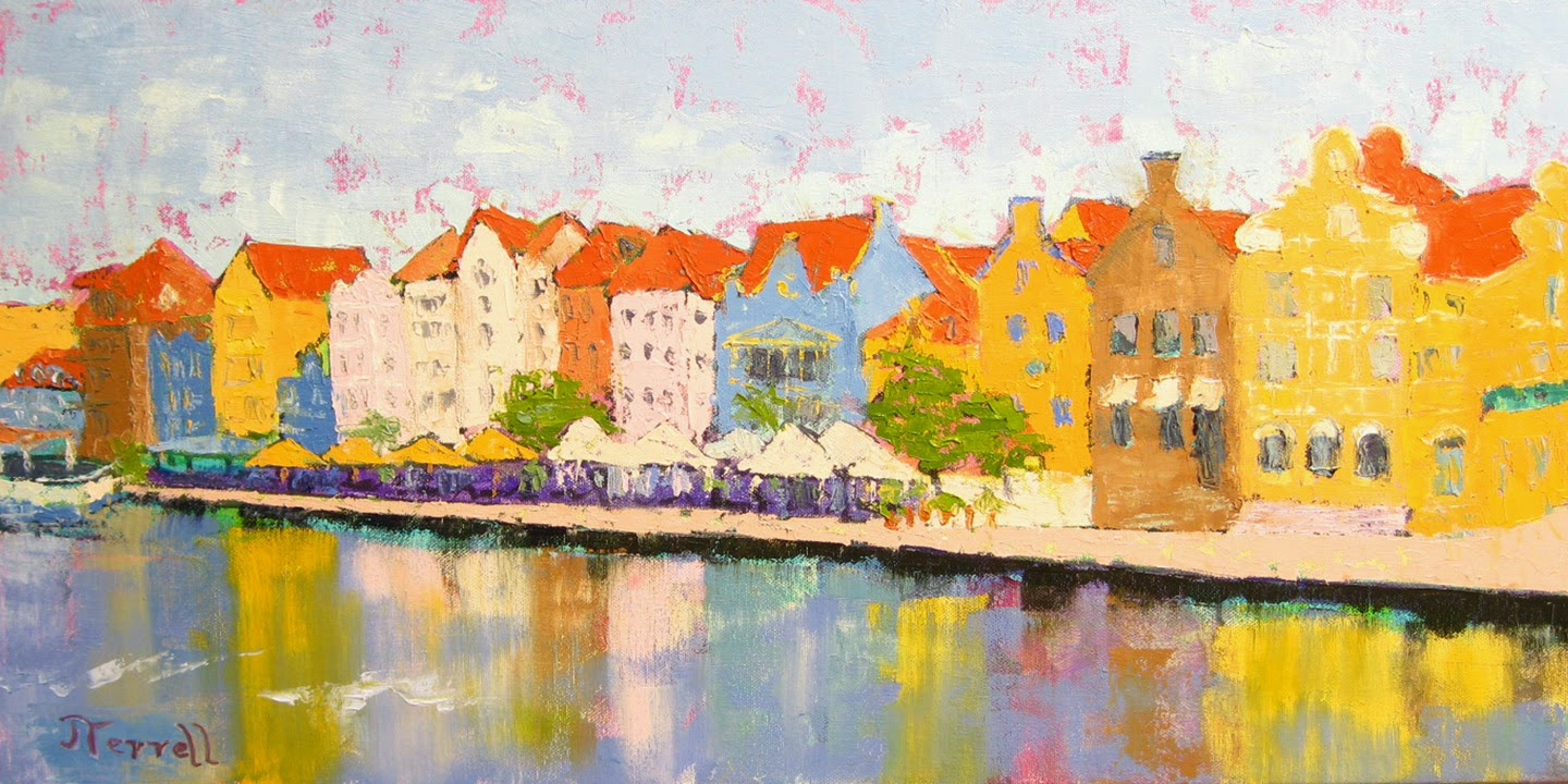 The facade of Willemstad, Curacao as seen from the Queen Emma Bridge.