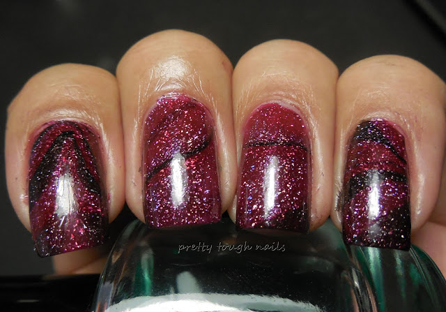 L.A. Girl 3D Holographic in Sparkle Ruby, Purple Effect and Black Illusion