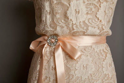Vintage lace wedding dresses, c Heavenly Vintage Brides 2013, detail of pastel lace wedding dress with ribbon tie