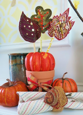 DIY Craft Tutorial: Scrap Fabric Fall Autumn Leaves Table Decoration and Napkin Rings Updated on August 31, 2015 Scrap Fabric Fall Leaves Table Decoration and Napkin Rings Scrap Fabric Fall Leaves Table Decoration and Napkin Rings Source: (c) purl3agony 2015 There are many ways to display these scrap fabric fall leaves to create a cheerful autumn decoration. There are many ways to display these scrap fabric fall leaves to create a cheerful autumn decoration. Source: (c) purl3agony 2015  The Fall months and the Thanksgiving holiday are one of my favorite seasons to decorate my home. Every year I find myself inspired by the beautiful autumn colors. This year, I grabbed a handful of scrap fabric to create some easy to sew fall leaves for a bright and cheerful table decoration. Then I added to my display by making some matching acorn napkin rings to complete my fall-inspired tablescape.  You can use almost any fabric for this project and finish your leaves with additions of beads, sequin, and buttons. I've included my pattern templates for my leaves and acorn with this tutorial, but you could use other shapes for this project, including pumpkins, apples or other leaves. Materials for Making Scrap Fabric Fall Leaves and Cute Little Acorn Materials for making scrap fabric fall leaves and cute little acorn Materials for making scrap fabric fall leaves and cute little acorn Source: (c) purl3agony 2015  I wanted to use materials I already had on hand for this project, so the supplies are very flexible and adaptable for you to use whatever you have.      scrap fabric - felt and fleece are great for this project, but you can use whatever little pieces of fabric you have. I used a different fabric for the front and back of my leaves, but this is optional. I also like using plastic vegetable bags (like the ones potatoes and onions come in) to add some texture to my leaves and acorns.      templates for leaf and acorn shapes, or whatever shapes you wish to use     embroidery floss in a few colors     beads, buttons, and sequin to decorate your finished pieces     fiber fill or cotton balls to stuff in your decorations (optional)     white craft glue or fabric glue     wooden dowels (for table decoration only)     basic sewing supplies including sewing needle and scissors  Basic leaf template for creating fall leaves table decoration Basic leaf template for creating fall leaves table decoration Source: (c) purl3agony 2015 Directions for Making Scrap Fabric Fall Leaves  I've included the directions for making and decorating three different styles of leaves. You can pick and choose which designs and decorations you want to use for your leaves. All these leaf designs follow the same basic directions below.  1. The first step in making your scrap fabric fall leaves is to print and cut out your leaf template. I have included all my pattern templates with this tutorial, but you can also use your own shapes. I sized each of my templates to be about 3 inches high, but you can adjust the size as you want.  I also chose to expose my seams and have them show on the outside of my leaf shapes, but you can also sew your pieces so the seams are on the inside. You might need to adjust the seam allowance accordingly. Trace your leaf template on your scrap fabric Trace your leaf template on your scrap fabric Source: (c) purl3agony 2015  2. After you've cut out your leaf template, trace it on to your piece of scrap fabric. I traced my template on the front of my fabric since I was leaving my seams exposed. If you want to hide your seams, you should trace your template on the back side of your fabric. I also sketched in my leaf detail so I could follow it with my stitch decoration.  Be sure to leave about 1/2 inch of seam allowance around your tracing. This extra seam allowance gives you some fabric to hold while doing your decorating. You can trim it closer when your leaves are sewn together and almost finished.  3. Now cut another piece of fabric about the same size to serve as your backing fabric for your leaf shape. Put this second piece of fabric to the side for now. Adding stitch details to your scrap fabric leaves Adding stitch details to your scrap fabric leaves Source: (c) purl3agony 2015  4. (Optional ) Next you can use some embroidery floss to stitch a vein design on your leaf. Before I started stitching, I pinned down a piece of purple vegetable netting over half my leaf for some additional color and interest. As I added my embroidery stitches, I made sure to stitch down the netting as I worked along my leaf.  5. Once you have added whatever stitch details you want, pin the front of your leaf to your backing piece of fabric. If you want your seams to show, pin your pieces together back to back. If you want to hide your seams, your fabric pieces should be pinned so that the front side of each is turned in.  6. Using your embroidery floss, stitch your pieces of fabric together following the outline of the template. Be sure to leave an opening about a 3/4 inch wide at the base of your leaf. This opening will be used to fill your leaf and inset your dowel stem. Fill and decorate your scrap fabric leaf with beads, buttons, or sequin. Fill and decorate your scrap fabric leaf with beads, buttons, or sequin. Source: (c) purl3agony 2015  7. Trim your excess fabric around your outline seam. I left about 3/16 of an inch of fabric around my sewn outline. I think this makes a nice finished edge.  8. (Optional) Add a little filling to your leaf using fiber fill or cotton. I just added a little bit of fill so my leaves were slightly puffy, but this is completely optional.  9. Add whatever additional details you want to your leaf including sequin, buttons, or beads. I used fabric glue to adhere my sequin to my leaf, but you can use any clear drying glue.   Template for scrap fabric oak leaf decoration Template for scrap fabric oak leaf decoration Source: (c) purl3agony 2015 Creating Different Styles of Scrap Fabric Leaves  I put together and decorated my green oak leaf using the same process.  1. Here, I chose a different color of fabric, but one that complimented my other leaves. I traced my oak leaf pattern on to the front of my green fabric with the intention of leaving my seams exposed.  2. Then I used the same template again to cut out a smaller version of my leaf from a yellow vegetable bag. Using embroidery floss to decorate your scrap fabric fall leaves Using embroidery floss to decorate your scrap fabric fall leaves Source: (c) purl3agony 2015  3. I used a bright color of embroidery floss and some tight stitches to sew the vein pattern on my leaf. These stitches also attached my vegetable netting to the front of my leaf.  4. I pinned my decorated leaf down to my backing fabric and stitched around my leaf outline with embroidery floss, leaving about a 3/4 inch opening at the base of my leaf. Decorating your scrap fabric fall leaves Decorating your scrap fabric fall leaves Source: (c) purl3agony 2015  5. Once I had sewn around my leaf shape, I trimmed my fabric leaving about 3/16 of an inch of fabric around my outline.  6. Then I stuffed my leaf with some fiber fill. To finish this leaf, I glued on a splash of small colorful beads. Template for scrap fabric maple leaf Template for scrap fabric maple leaf Source: (c) purl3agony 2015 Making a Scrap Fabric Maple Leaf  I made my maple leaf in a slightly different way, but following the same directions.  1. I traced my maple leaf template on the front of my fabric and cut it out leaving about an inch seam allowance. I then added some details by stitching in the leaf veins using embroidery floss.  2. When I was done, I pinned my front piece of fabric to my backing fabric and stitched around my leaf outline, joining the two pieces of fabric together. I left about 3/4 of an inch opening at the base of my leaf for filling and for my stem. Scrap fabric maple leaf for fall decorating Scrap fabric maple leaf for fall decorating Source: (c) purl3agony 2015  3. Once I had stitched the outline of my leaf, I trimmed my front fabric leaving about a 3/16 of seam allowance around my stitches.  4. Then I trimmed my backing fabric with about 3/16 seam allowance beyond my front fabric. This allowed my backing fabric to show around the edges of my front fabric, adding more color to the design.  5. Finally, I stuffed my leaf with a little bit of fiber fill and glued on some small buttons to decorate my fabric leaf. Adding Standing Stems to Your Scrap Fabric Leaves Source: (c) purl3agony 2015  You can add dowels or sticks to the base of your leaves so you can display them. Adding stems to your scrap fabric fall leaf decorations Adding stems to your scrap fabric fall leaf decorations Source: (c) purl3agony  I used a piece of 1/4 inch wooden dowel for my stems. I cut my dowel into 9 inch lengths, but you may want to adjust your length depending on how you plan to display your leaves. To adhere my stems to my leaves, I added a few drops of glue just inside the bottom opening of my leaf. I stuck my dowel through the opening and pushed it into my leaf all the way to the top seam. I then applied a little pressure so the glue would stick to the dowel and seal the opening. You can hold your fabric and glue to your dowel while it dries by using paper or binder clips.  You can use your dowel in its natural state, paint it a different color (which I would do before your cut it into pieces), or wrap your dowel with washi tape to add some additional color. Displaying Your Scrap Fabric Fall Leaves Use an empty jar wrapped with twigs to display your scrap fabric fall leaves Use an empty jar wrapped with twigs to display your scrap fabric fall leaves Source: (c) purl3agony 2015  Once you've made a bunch of scrap fabric leaves, there are many ways to display them and use them around your home as decoration.  1. Take a clean, empty jar (I used a relish jar) and a handful of straight twigs or sticks. Trim your sticks so that are about the same length as the height of your jar. With a hot glue gun, glue the sticks on the side of your jar, working about an inch at a time. Use thinner twigs to fill in any spaces or gaps between your sticks. When the glue is dry, add a twine or ribbon bow to your container.  To help your scrap fabric leaves stand up, fill your jar with cotton balls, glass pebbles, or small rocks, then arrange the stems of your leaves in your container. Plant the stems of your scrap fabric fall leaves in a small ceramic pot. Plant the stems of your scrap fabric fall leaves in a small ceramic pot. Source: (c) purl3agony 2015  2. Decorate a small ceramic pot with some wrapping paper and ribbon to create an arrangement for your scrap fabric leaves. To make my stems stand up in this pot, I wrapped one of my husband's brown socks into a roll and put it inside my container. I then stuck my stems in between the folds of the sock to make them stay in place.  3. You can also add your fabric leaves to any potted plant you already have. These leaves placed into a lovely potted mum, marigold, or rosemary plant would make a festive table centerpiece or decoration. Display your scrap fabric leaves using a real or artificial pumpkin as a stand. Display your scrap fabric leaves using a real or artificial pumpkin as a stand. Source: (c) purl3agony 2015  4. You can also use a small pumpkin (real or foam) as a display stand for your fabric leaves. These would make festive decorations for a Thanksgiving table or at a Halloween party.  Take a screwdriver and make a small starter hole in your pumpkin for where you want to stick your leaf stem. Using just your hand, take a drill bit that is the same width as your stem and work it through your pumpkin to create a hole. I placed a few of my leaf stems on an angle in my pumpkin to make a more interesting display.  5. You can also use these scrap fabric leaves to add a fall look to a floral bouquet. Your fabric leaves can add a touch of autumn color to any vase of cut flowers. How to Make a Scrap Fabric Napkin Ring Finish your scrap fabric fall table decorations with some matching napkin rings. Finish your scrap fabric fall table decorations with some matching napkin rings. Source: (c) purl3agony 2015  These scrap fabric napkin rings are a great accessory for your scrap fabric fall leaf decoration and to continue the autumn theme at your table. I used an acorn for my napkin ring decoration, but your can use any of the leaf templates or other shapes to make your napkin rings. Acorn template for scrap fabric napkin ring Acorn template for scrap fabric napkin ring Source: (c) purl3agony 2015  I sized and printed out my acorn template so it was about 2 inches high, but you can adjust your template to the size you need. I also created and stitched my acorn so the seams were not showing, but you can leave your seams exposed as I did with my leaves above. You may want to make your template slightly smaller if you plan to expose your seams.  1. Trace your template on the back of your fabric. Cut out your shape leaving about 1 inch of seam allowance on all sides.  2. Working on the front of your fabric, add whatever decorative details you choose. I cut out a piece of plastic netting for the cap of my acorn and stitched it in place on my fabric.  3. Choose a backing fabric for your acorn and pin the front of your shape face to face with your backing fabric. The back side of your fabric should now be showing on both sides. Sew around your outline, leaving a one inch opening on the side or bottom of your shape. Trim your excess fabric so you only have about 1/4 inch of seam allowance around your outline.  4. Turn your acorn so that the right side is showing and stuff it with a little bit of fiber fill. Sew your opening closed with a few hand stitches.  I omitted the stem from my original acorn template, so once my shape was complete, I glued a small piece of twig on to serve as a stem.   Materials for making a scrap fabric napkin ring Materials for making a scrap fabric napkin ring Source: (c) purl3agony 2015 Adding Your Scrap Fabric Shape to Your Napkin Ring  Now that your acorn or other shape is complete, you can adhere it to your napkin ring. There are a couple ways to do this:  1. Buy a pre-made napkin ring in a style you like and hot glue your scrap fabric shape to the front of it. This is quick, easy, and a great way to add a handmade touch to inexpensive napkin rings.  2. Or you can make your own rings using recycled toilet paper or paper towel rolls. I cut a toilet paper roll into 3/4 inch rings. Then I wrapped each cardboard ring with yarn, but you could also use twine. You can wrap a cardboard ring with yarn or twine to make a napkin ring. You can wrap a cardboard ring with yarn or twine to make a napkin ring. Source: (c) purl3agony 2015  To do this:      Cut about a 4 foot length of yarn or twine and roll it into a ball so it will fit through the center of your cardboard ring.     Add a drop of hot glue to the inside of your ring. While it is still hot, stick the end of your yarn or twine in your glue. Let the glue dry.     Start to cover your ring with your yarn or twine in even wraps. When your ring is completely wrapped, cut the end of your yarn. Then use another drop of hot glue to stick the end to the inside of your ring.  Attaching your scrap fabric acorn to your napkin ring. Attaching your scrap fabric acorn to your napkin ring. Source: (c) purl3agony 2015  Now you can either:  1. Glue your acorn or other decoration to the front of your wrapped ring using hot glue.  2. Glue or sew a jewelry pin back to the back side of your scrap fabric shape. Open the pin back and slide the pin through a few wraps of your yarn so your decoration is held firmly to your napkin ring. Then close your pin back safely.  Using pin backs is a fun because it allows your guests to keep your scrap fabric decorations to wear as a pin or brooch. Fall decorating with scrap fabric leaves and acorns Fall decorating with scrap fabric leaves and acorns Source: (c) purl3agony 2015  All projects copyrighted © 2015 by Donna Herron. All rights reserved
