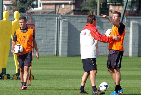 Steven Gerrard gestures at the fan while assistant manager Colin Pascoe trying to calm him down