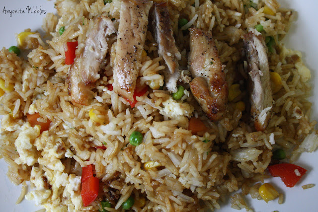 Vegetable fried rice with strips of chicken candy