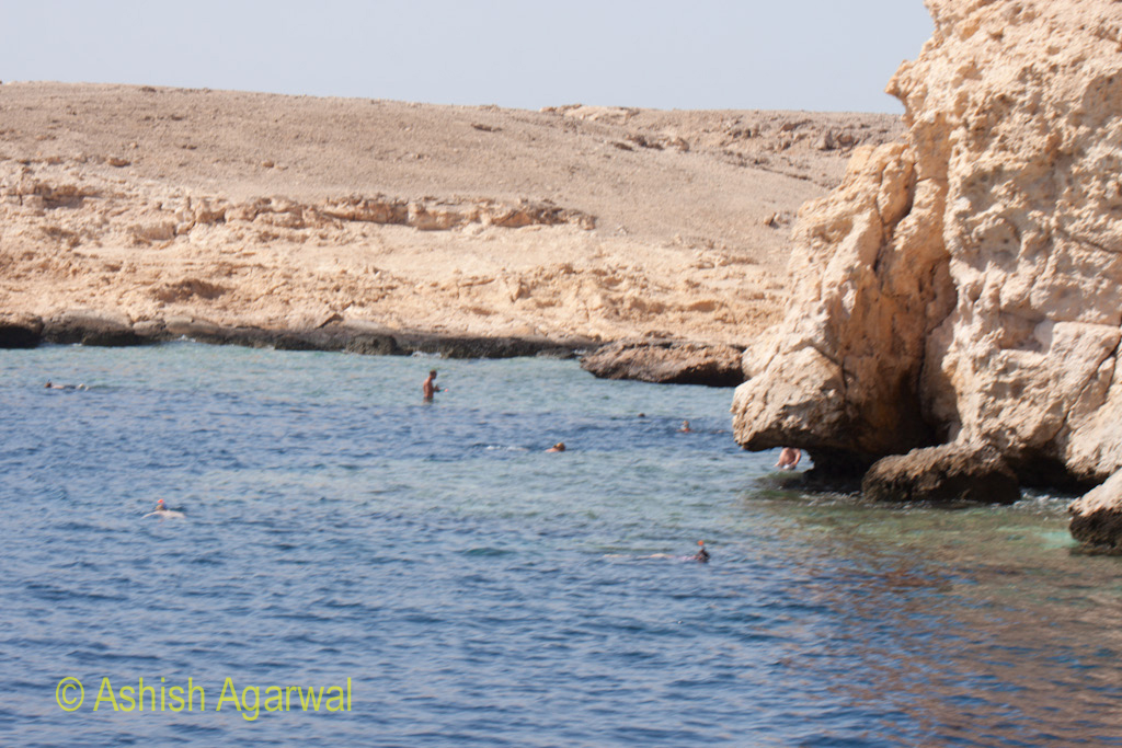 Tourists in the water near the shoreline of the Ras Muhammed park in the Red Sea in Egypt