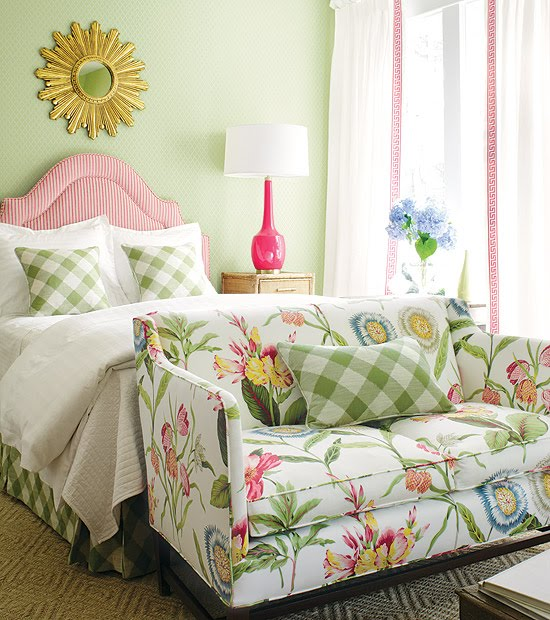 bed room pink head board white bedding green blue sofa loveseat