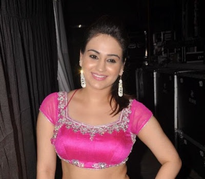 Exotic Aksha hot dance photos at aadu magadura bujji audio launch