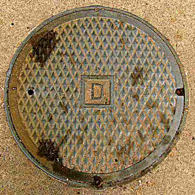 Sewer cover with the letter D - which stands for David's Divot, a piece of music