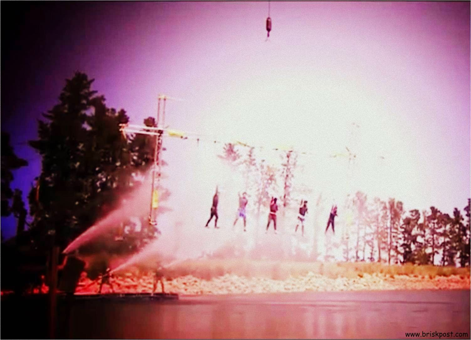 Khatron Ke Khiladi contestants making balance on a rope in front of forceful shower over river water during Standing Ovation Stunt in Fear Factor Darr Ka Blockbuster