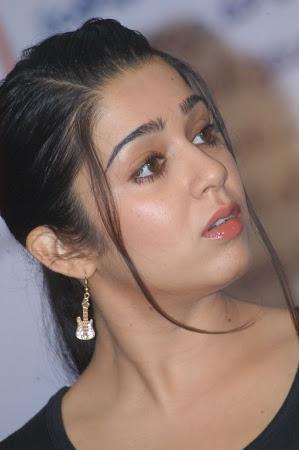 fair and radinant Charmi stills santosham 11th anniversary awards meet