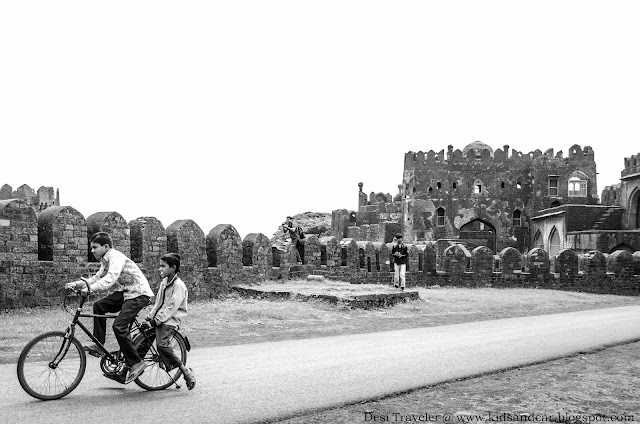 boy riding cycle inside the Bidar Fort