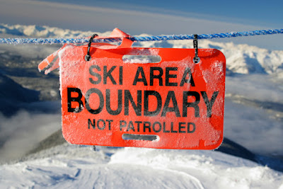 "A sign in the mountains reads ""Ski Area Boundary-Not Patrolled"""