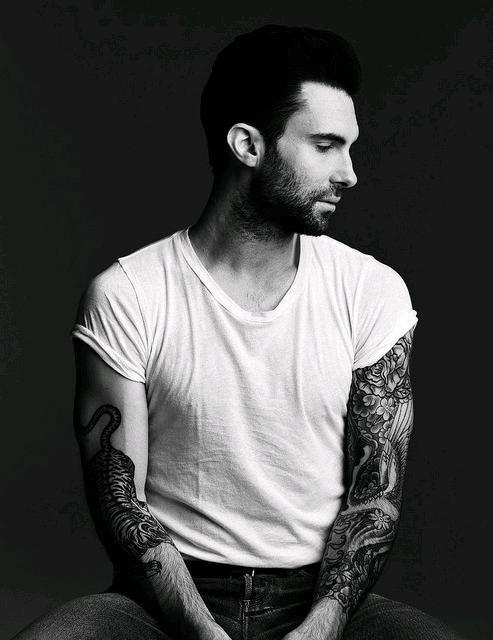 Adam Levine when appearing and showed cool tattoos on his hand