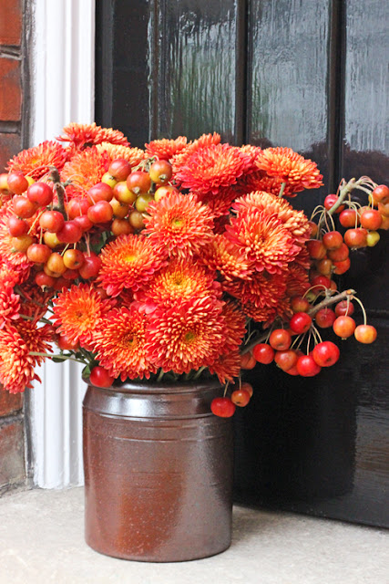 Orange Chrysanthemums and crabapples