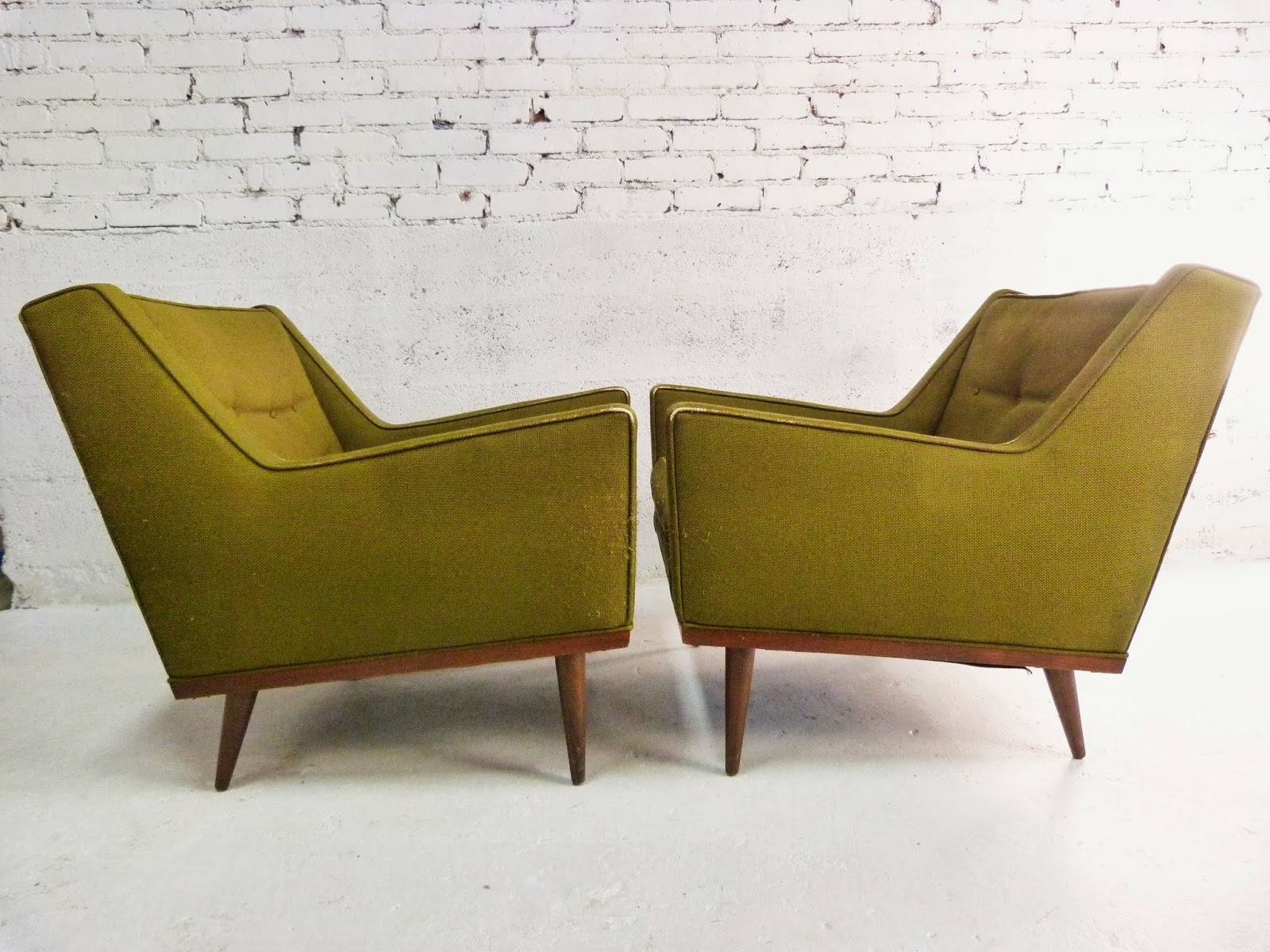 a pair of green midcentury modern sculptural lounge chairs