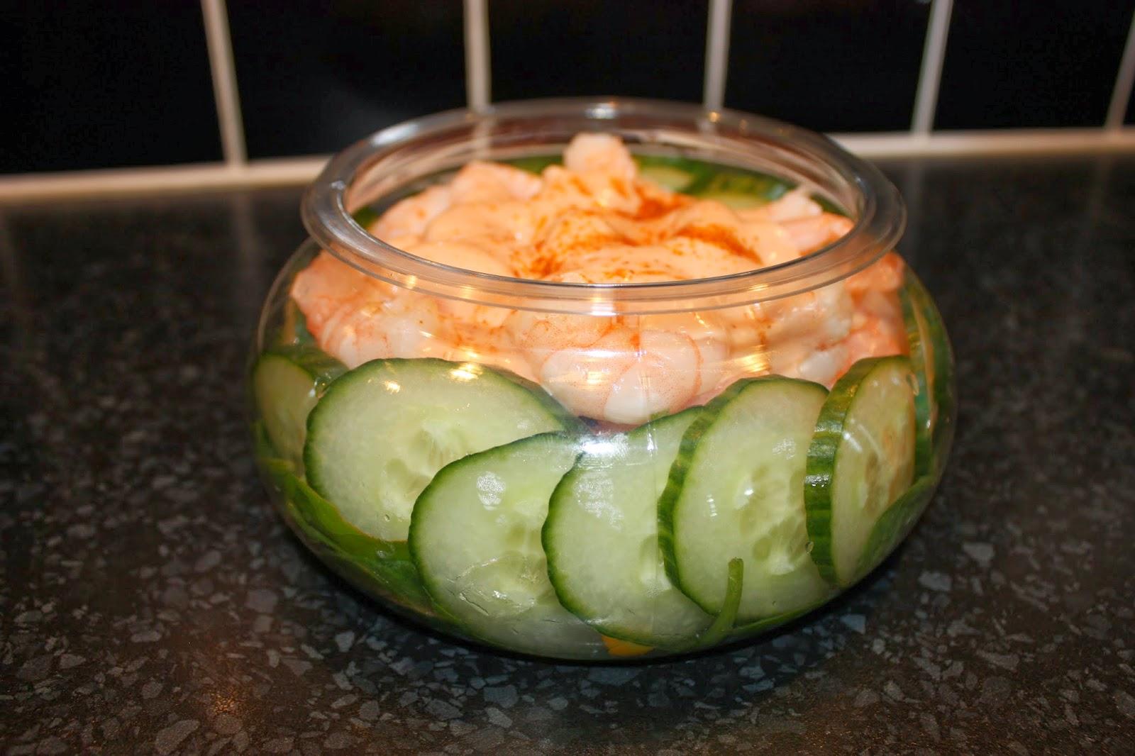 A Cauldron pot showing a layered prawn salad