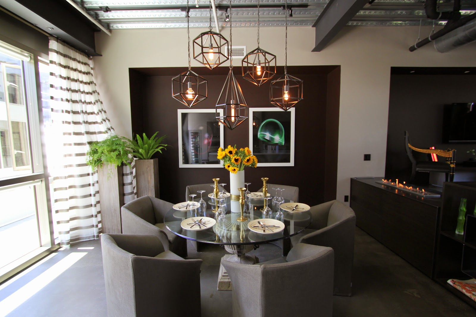 Dwell home tours atwater crossing industrial townhouse for Dining room ideas for townhouse