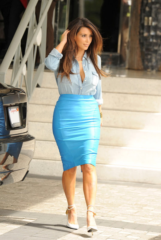 Kim Kardashian wearing a denim shirt and a blue skirt