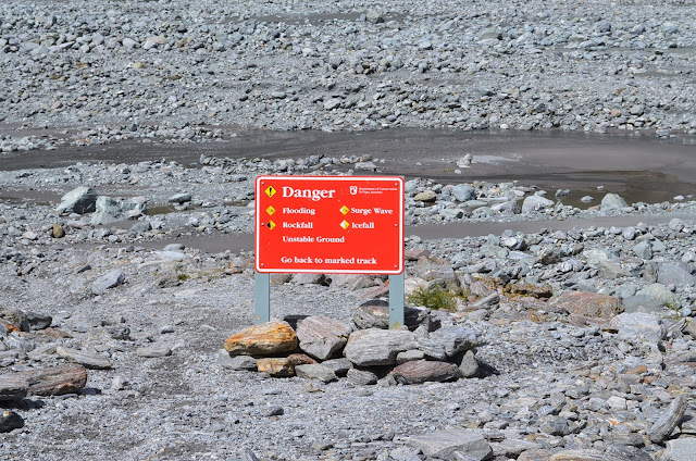 Safety sign boards up on display at the hiking path of Fox Glacier, New Zealand