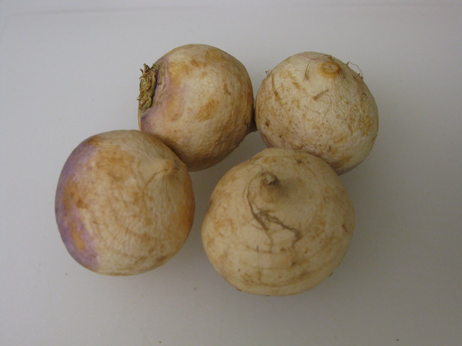 Peel the turnips and dice them into half inch pieces.