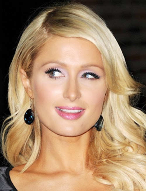 Paris Hilton wearing a pair of Jenny Dayco earrings