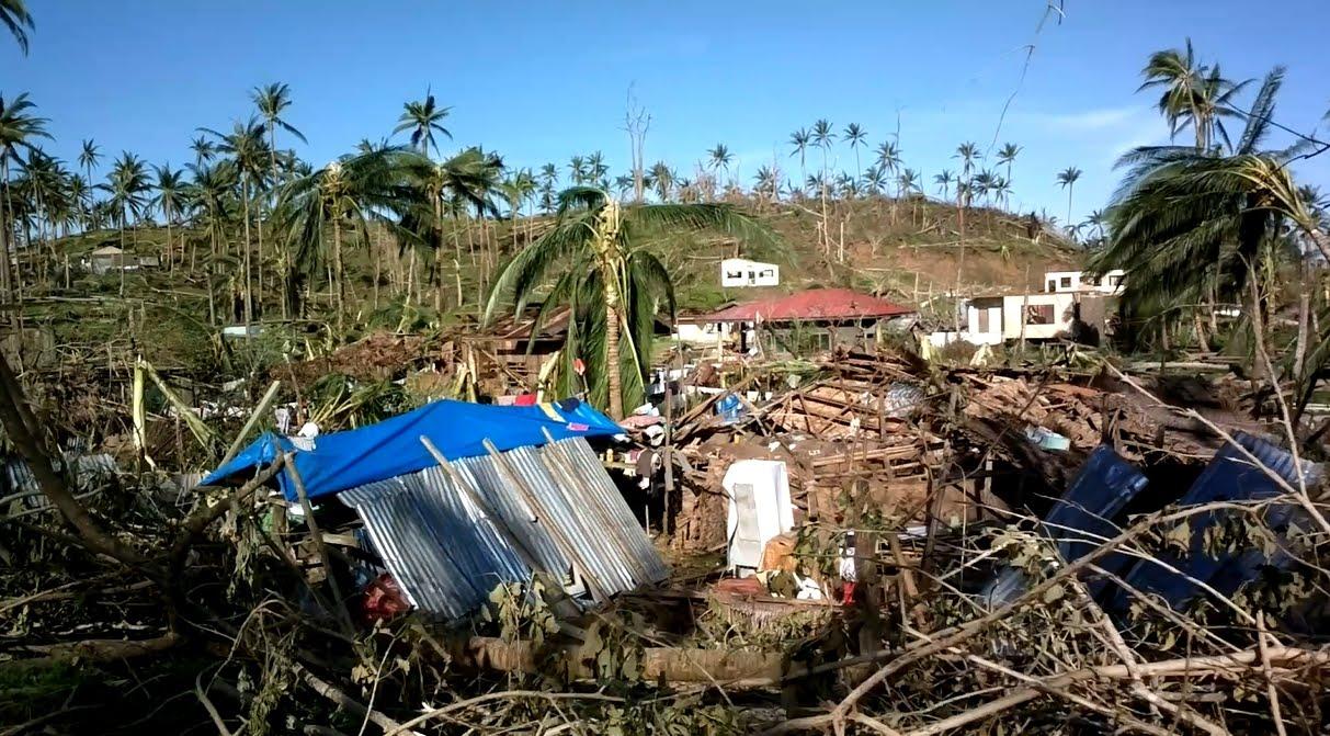 "typhoon pablo Baganga's sunrise boulevard rises amidst the havoc brought by typhoon ""pablo""."