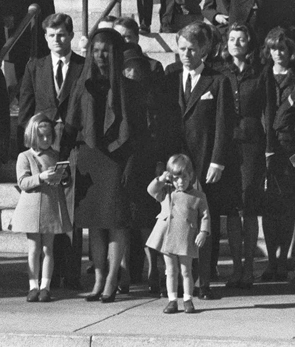 john john saluting funeral procession