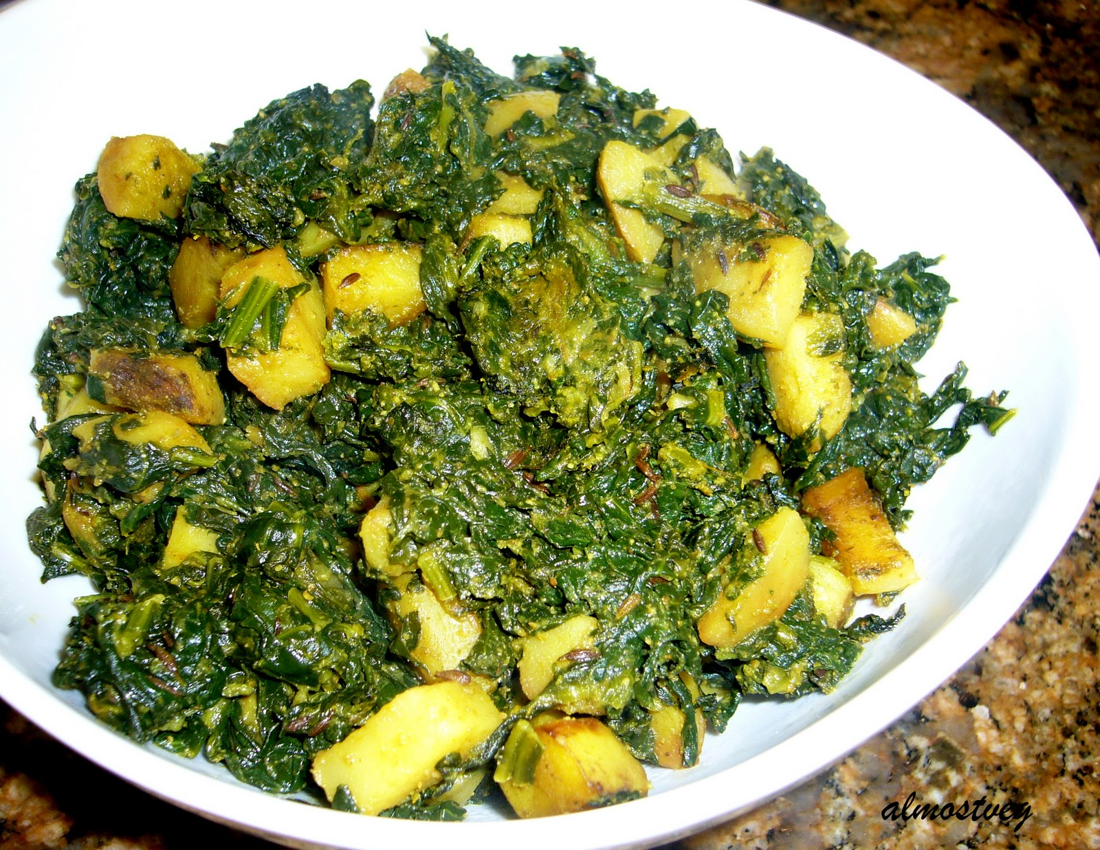 Stir fried spinach and potatoes with mild spices