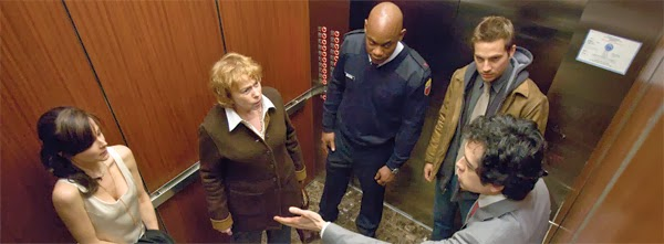 people inside elevator. the complete movie is almost entirely set in an elevator that gets stuck with five people inside it. as film progresses you learn each of them