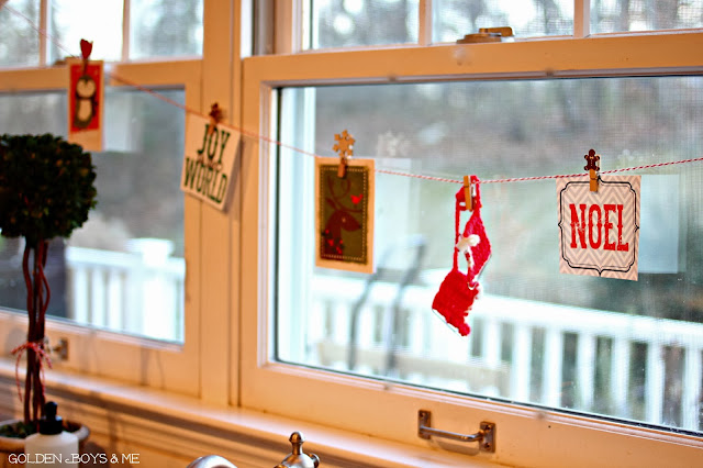 Christmas card garland from baker's twine in kitchen-www.goldenboysandme.com