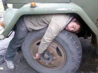 funny picture: drunk falling asleep at the wheel of the truck