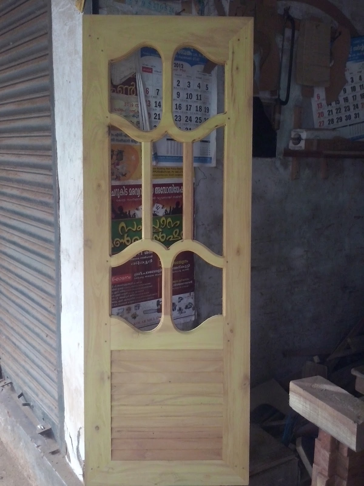 Kerala style carpenter works and designs wooden window for Wooden window design with glass