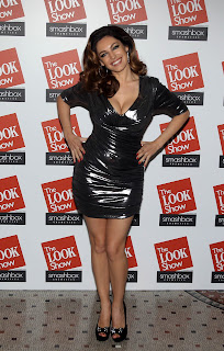 Kelly Brook shows off her assets in a tight dress