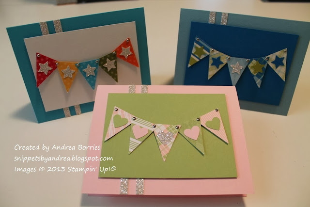 Three cards with punched triangles arranged like a banner, one neutral color combo, one masculine (blue and green) and one feminine (pink and light green).