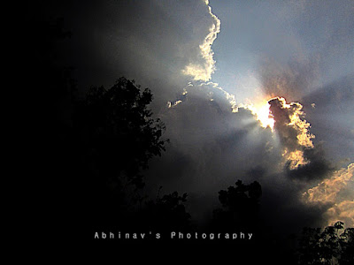 Sky photo : Rays piercing through rain clouds( from Cheruvally, Kerala )