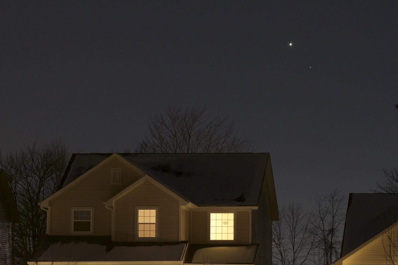 mars and venus over a house