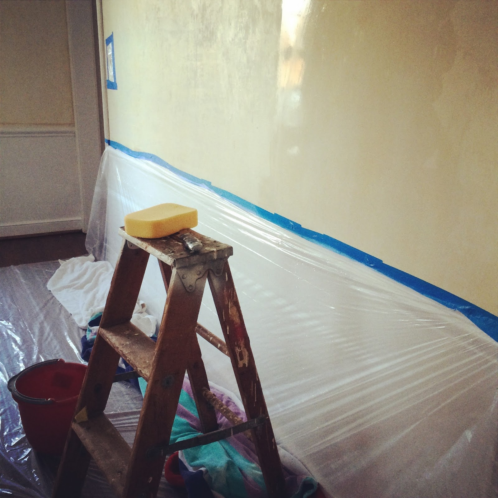 how do you remove old wallpaper glue from walls